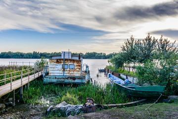 Two moored boats near a pontoon, in summer season. Horizontal vi