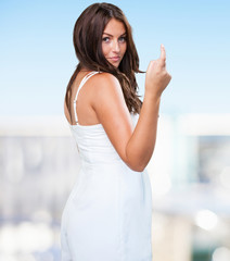 pretty young woman doing a sexy gesture