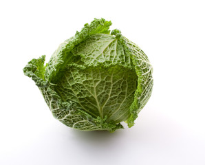 head of fresh cabbage on a white background.ïîèñê
