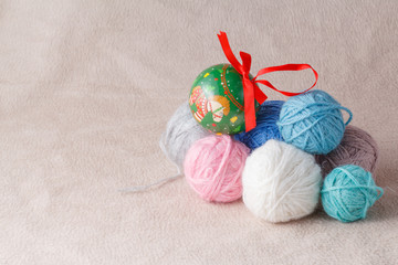Heap of wool clew on soft background with christmas decoration