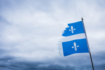 Metaphor using a Broken Quebec Flag and a Sad Sky.