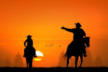 people on horseback at sunset