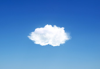 Single cloud flying in the deep blue sky