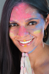 Beautiful young brunette girl with colorful decorated face