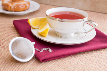 Breakfast with pastries, and hot tea with lemon.