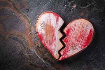 Broken heart on slate background
