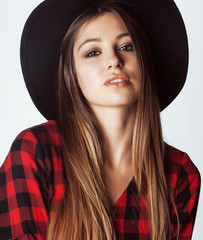 young pretty brunette girl hipster in hat on white background casual close up dreaming smiling