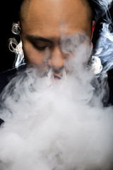 Man with concealed identity smoking a controversial vape is a health risk