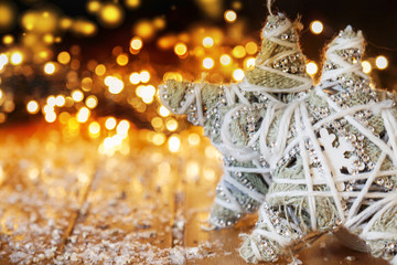 stars rag in front of christmas lights on wooden background