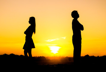 Silhouette of a angry woman and man on each other / Relationship difficulties / Couple break up