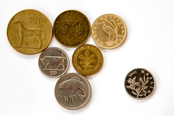 Obsolete European coins with plants and animals on them