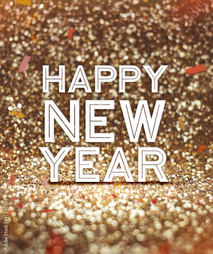 happy new year word at sparkling gold glitter background with co