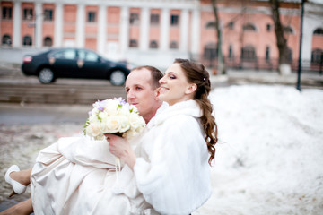 Bride and groom in winter snow city