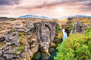 Staande foto Canyon Cliffs and deep fissure in Thingvellir National Park, southern I