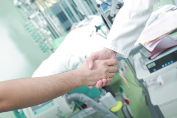Doctor handshake as a sign of the success of treatment