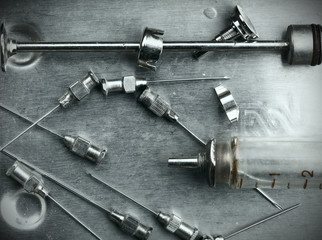 Obsolete glass syringe and needles