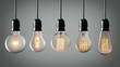 Vintage hanging light bulbs over gray