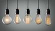 Vintage hanging light bulbs over gray
