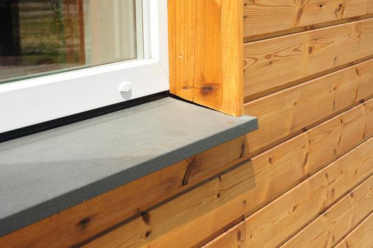 Close-up on single plastic window sill detail. Install window