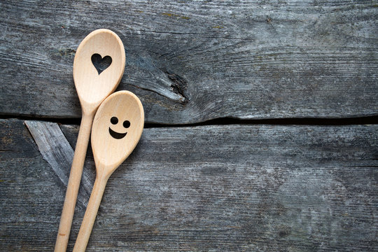 smiling wooden spoons on kitchen table