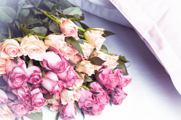 Beautiful multicolored roses on a pillow.