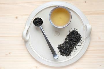 Tea set on a ceramic plate