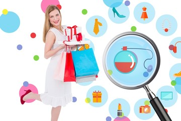 Composite image of pretty blonde with presents