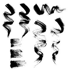 Vector set of grunge brush strokes. Black mascara brush strokes set. Black paint spots vector set
