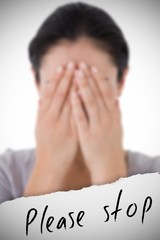 Composite image of sad woman hiding her face