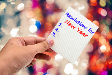 New Year's  Resolution handwriting on a sticky note
