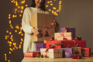 Female holding christmas gift box