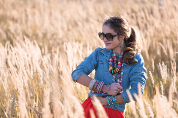 Portrait of attractive girl on the field in sunglasses