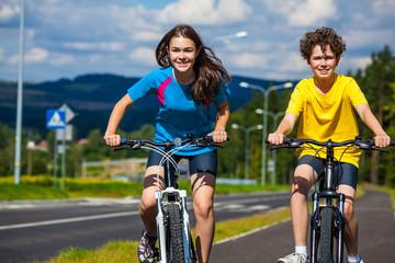 Aluminium Prints Cycling Healthy lifestyle - teenage girl and boy cycling