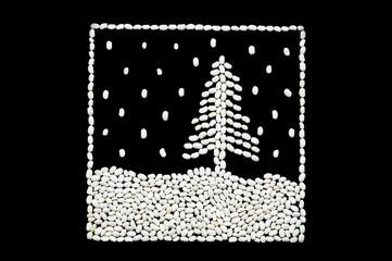 snow falls on  Christmas fir-tree at night