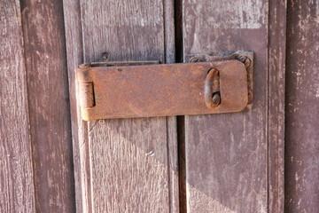 Old key on wood door