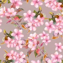 Pink apple, cherry (sakura) flowers. Seamless floral template. Watercolour on grey background
