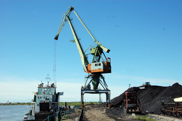 Dockside cargo crane at river port Kolyma