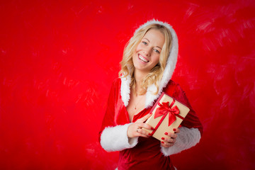 Woman in Christmas costume holding a gift box