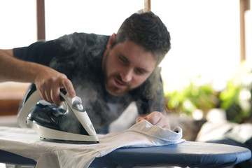 Modern man doing the ironing