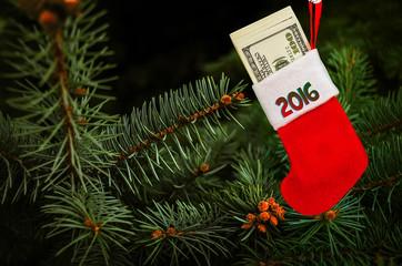 stocking full of hundred-dollar bills on the Christmas tree
