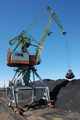 Dockside cargo crane uploads coal at Kolyma port