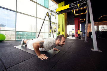 cross-training, muscular man doing push ups.