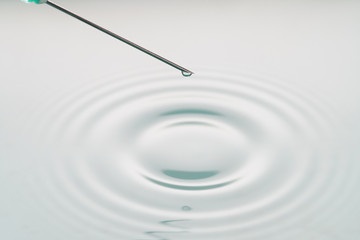 liquid drop on the tip of syringe