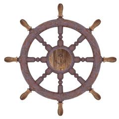 Rusty nautical wheel isolated on white