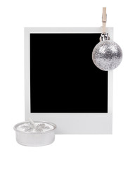 Silver christmas candle and photo frame with silver decoration ball on clothespin