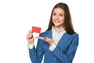 Smiling business woman showing blank credit card in blue suit, isolated over white background