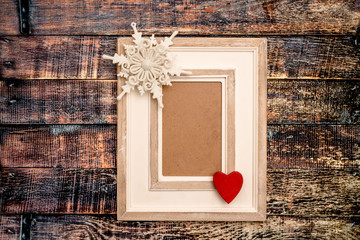 Decorative picture frame on wooden background