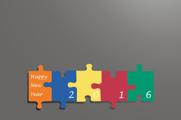 New year card of puzzle pieces on the grey background
