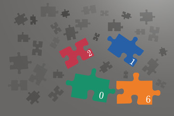 Coloful puzzle pieces on the grey background