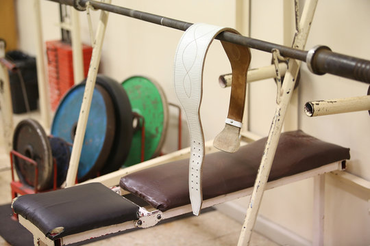 belt and colourful weights for powerlifting
